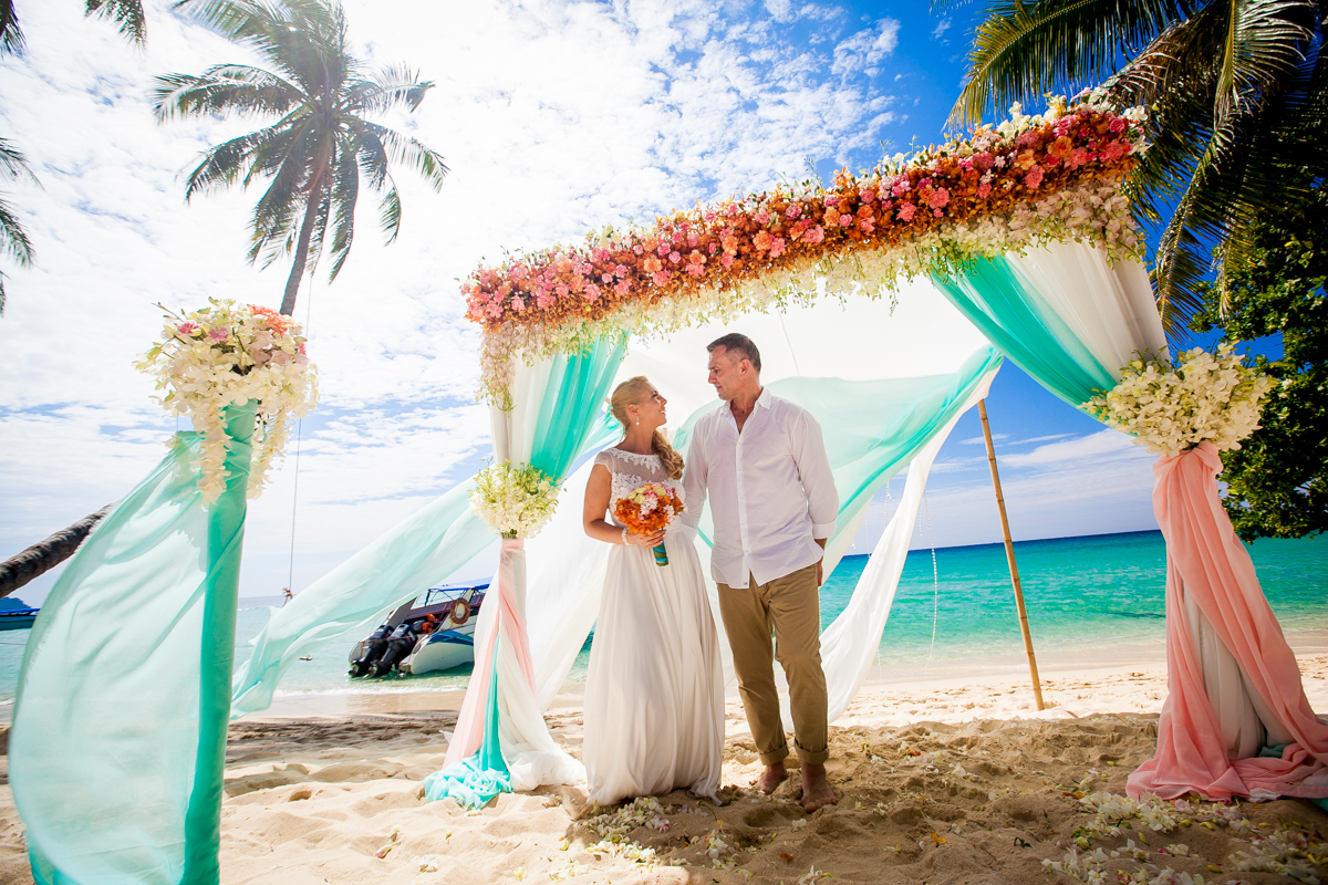 Beautiful fresh flower wedding ceremony at Cabana Resort beach